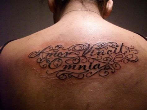 love conquers all latin tattoo designs conquers all by inkking724 tattoomagz