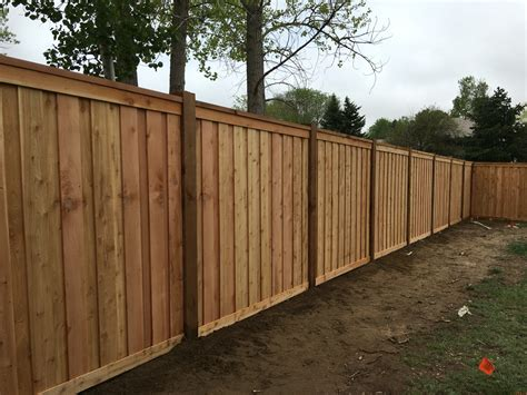 7 tall cedar privacy fence with 6x6 posts 2x6 top cap 6 quot overlapping pickets and 1x4 top and