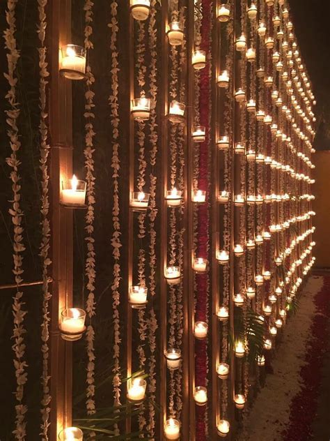 Diya wall   led   Wedding decorations, Indian wedding