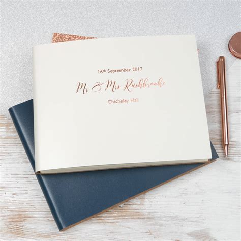 guest book pictures personalised leather bound wedding guest book by begolden