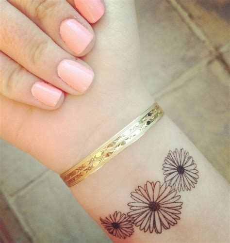 daisy wrist tattoos 31 beautiful flower tattoos design on wrist