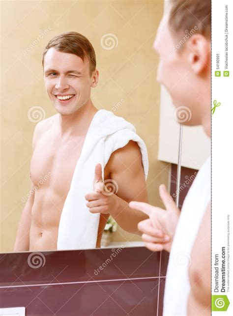 Giving In Bathroom by Giving Himself Wink I Front Of Mirror Stock Photo