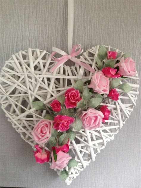 Wicker heart that has been decorated using foam roses