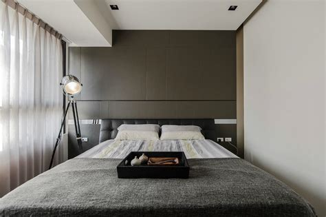 minimalist bedroom design stone and wood make a dark masculine interior