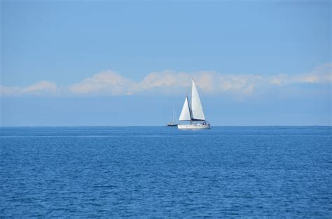sky boat free images sea water ocean horizon sky boat wind