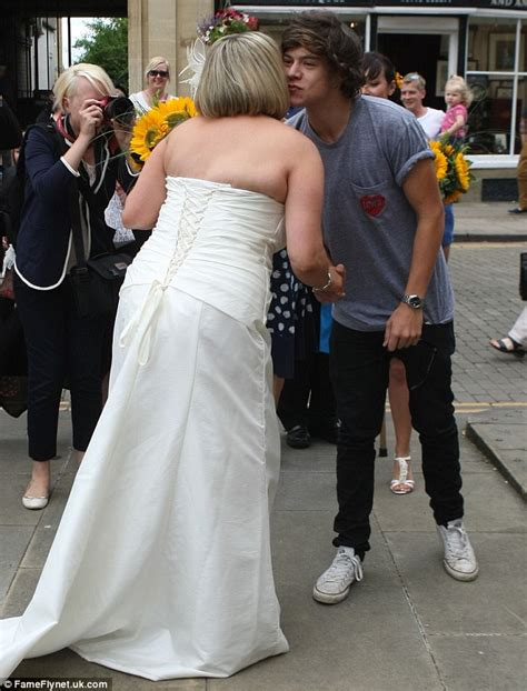 harry styles photos one direction walks to a studios one direction s harry styles gives new bride a kiss as he