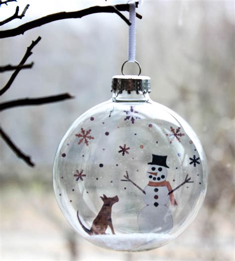 glass pup and snowman holiday ornament features happy