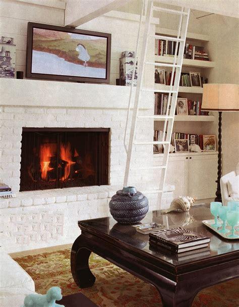 white brick fireplace bookshelves living room