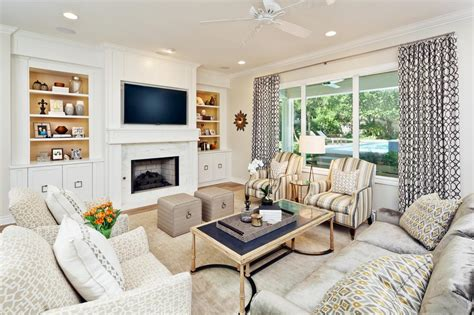 chic transitional living room with striped armchairs a neutral color palette allows for a fun