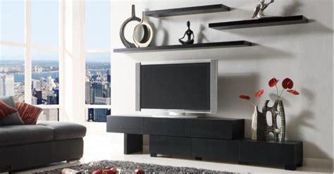 i like the floating shelves the tv design
