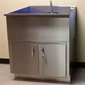 stainless steel laundry utility sink with base cabinet