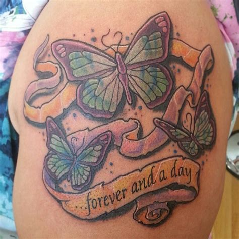 blue horseshoe tattoo butterfly memorial done by artist paulie thrasher