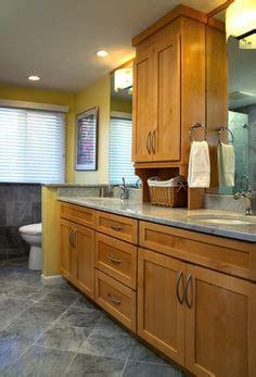 cabinet between bathroom sinks z completed bath storage cabinet w framed mirror on