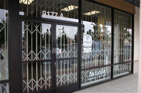 cdc installs commercial grade scissor gates  storefronts