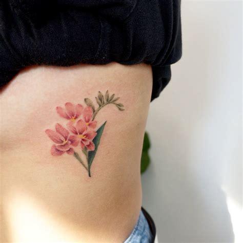 freesia tattoo designs 22 beautiful and delicate freesia designs tattooadore