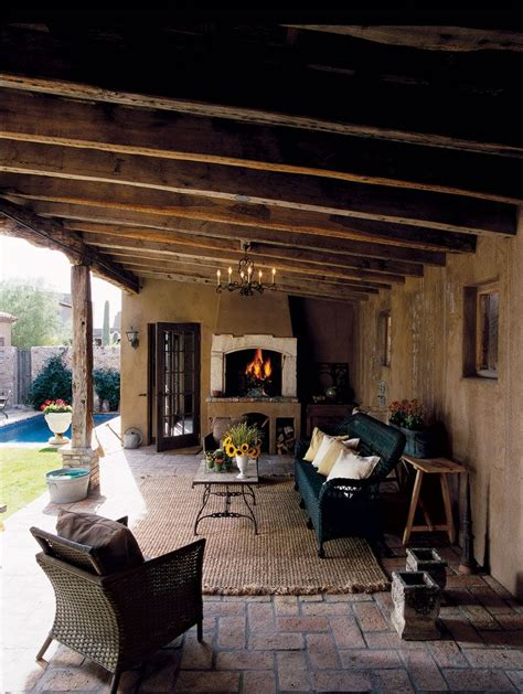 outdoor living room with fireplace mediterranean inspired backyard and covered patio porch