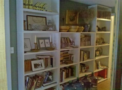 bookcase in dining room open up a staircase and create a fabulous mudroom