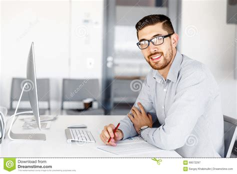 Office Worker At Desk Office Worker Sitting At Desk Stock Photo Image 68572297