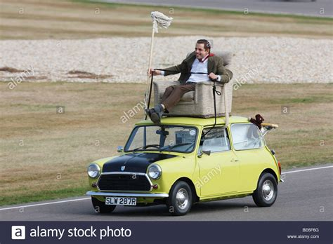 mr bean sofa on car mr bean driving a classic mini from arm chair on its roof