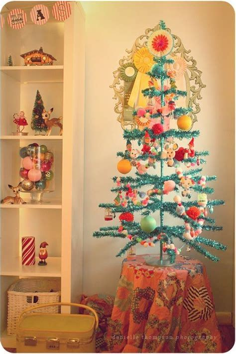 vintage tinsel tree  @Bebe Trimble  you need this in
