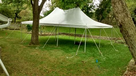 backyard with a 20 x 30 rope and pole tent in iowa