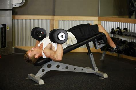 bench press with dumbbells decline dumbbell bench press exercise guide and video