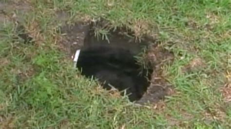 Small Sinkhole In Backyard by Florida Calls 911 After Falling Into Sinkhole