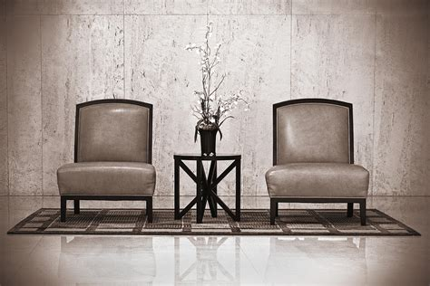 Armchair For 2 Two Chairs And A Table With A Plant By Rudy Umans