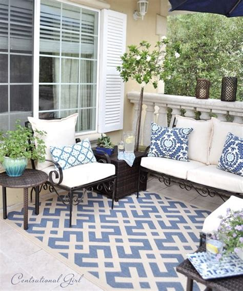 used furniture and rugs use an outdoor rug to anchor backyard furniture home