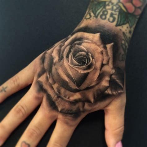 rose tattoo on hand with name thetattooninja rose rose hand tattoo