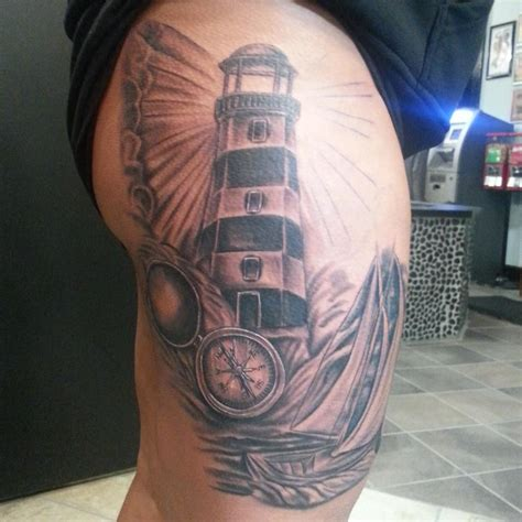 compass lighthouse tattoo grey compass and lighthouse tattoo on thigh