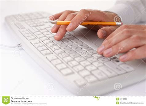 free stock photo hands over keyboard man typing on a computer keyboard at work royalty free