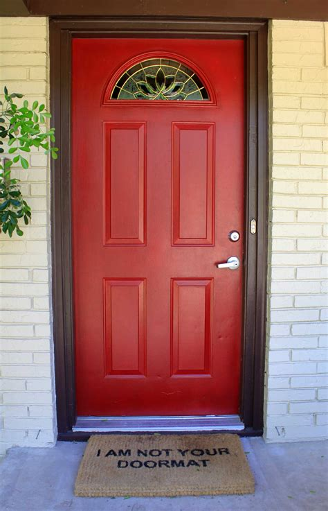 red front door as surprising door design for modern home