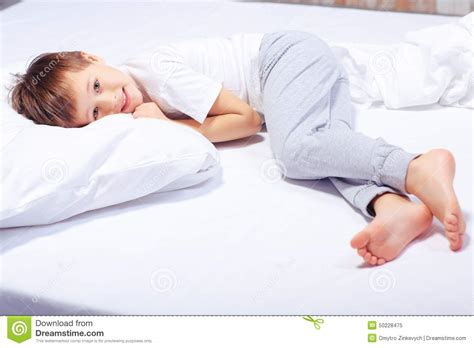 portrait of a boy in bed with pajama stock image image