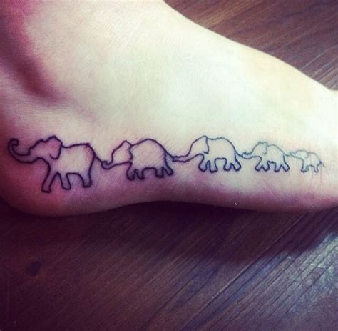tattoo family represent elephant tattoo each elephant represents one of my family
