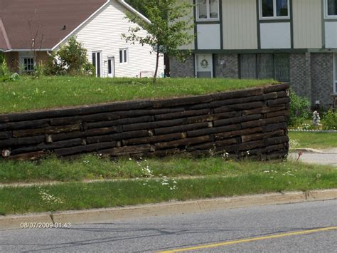 How To Build A Garden Wall How To Build Retaining Walls With Railroad Ties Incoming