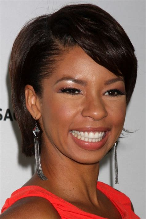 pic of black women side swept bangs and bun hairstyle 20 black hairstyles with bangs oozing mismatched chic