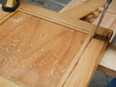how to add glass to kitchen cabinet doors update kitchen cabinets with glass inserts hgtv