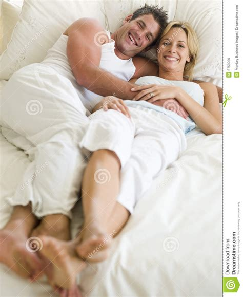 lying in bed smiling royalty free stock image