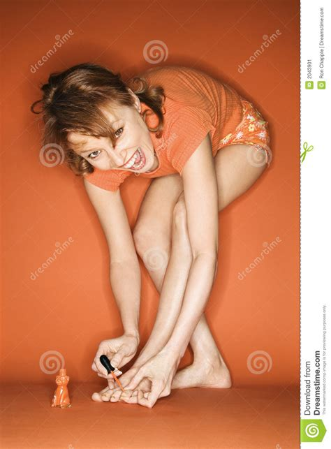 teen girl painted toenails caucasian woman painting her toenails stock image image