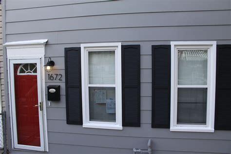 grey house with red door gray house red door black shutters
