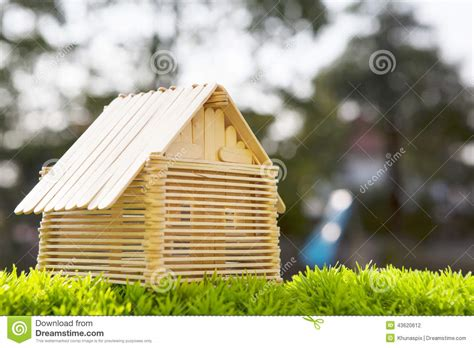 Superior House Construction App #4: House-model-make-wood-stick-artificial-gra-grass-field-blurry-background-use-home-nad-housing-abstract-43620612.jpg