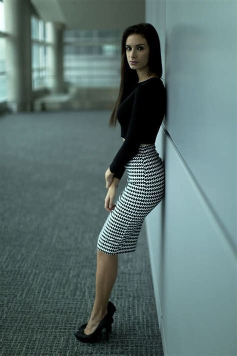 tight houndstooth pencil skirt black blouse and black