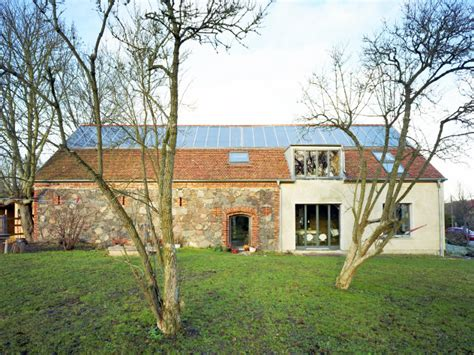 crumbling barn renovated into rammed earth ihlow