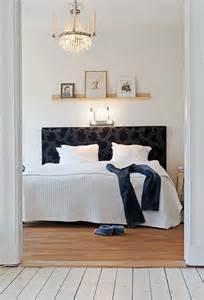 shelving above bed light shelf bed scandinavian bedrooms