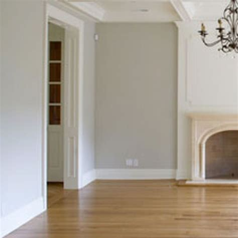 warm oak floors with cool gray walls decorating