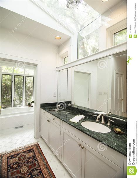Simple Modern Bathroom With Black Granite Counter Stock