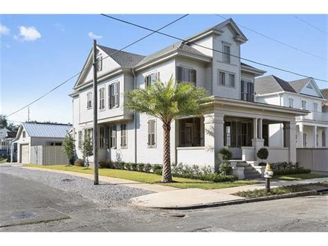 fully renovated uptown home with garage driveway tops