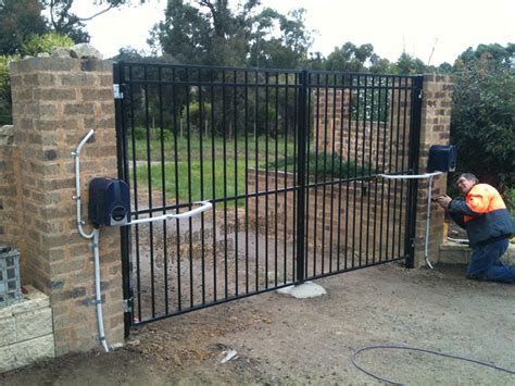 swinging gates melbourne flat top with articulated arm motors auto gates and fencing