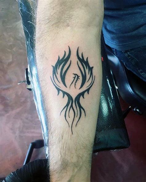 tattoo phoenix hand inner forearm black ink male phoenix tattoo designs alas